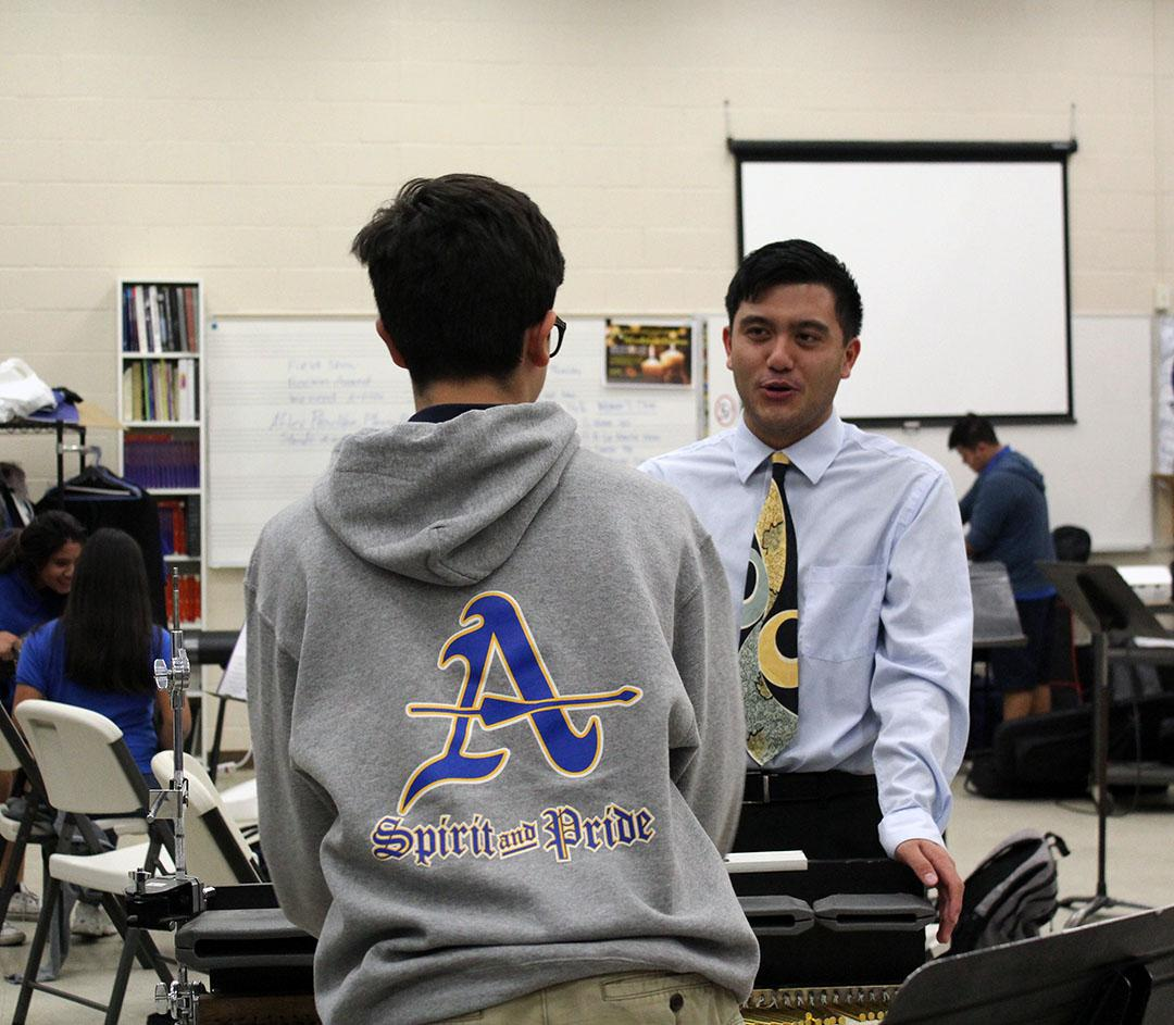 Mr. Banas speaks to a percussion member.