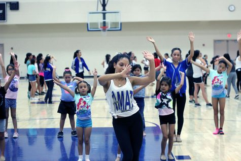 Kaila Reid leading beginning dancers in their routine.