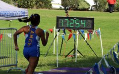 Girls' x-country wins league meet; boys place second