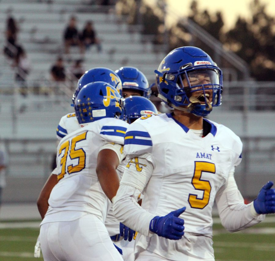 Mason Montanez celebrating after a successful play.