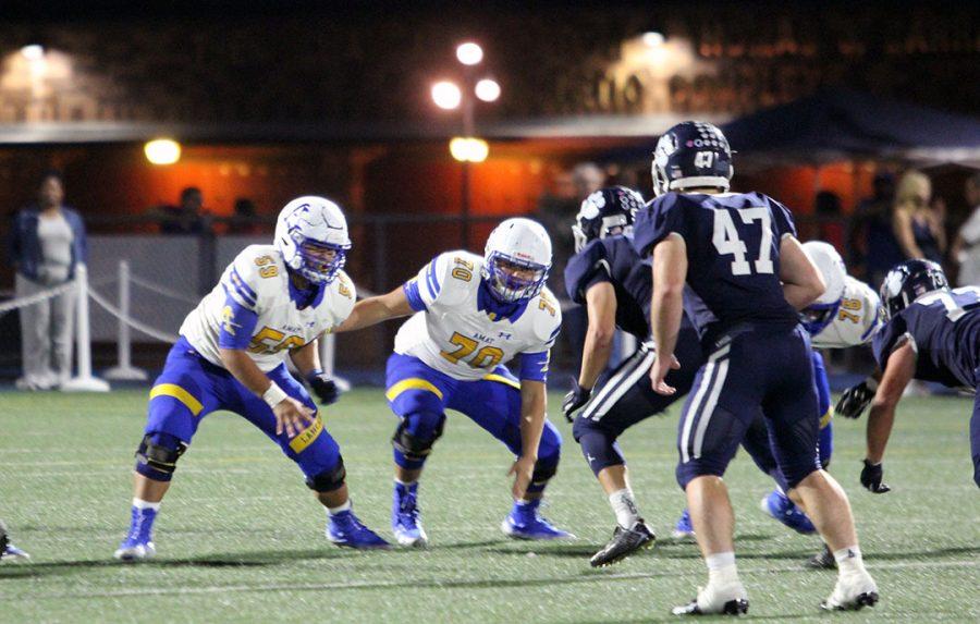 Romeo Hernandez prepares to tackle.