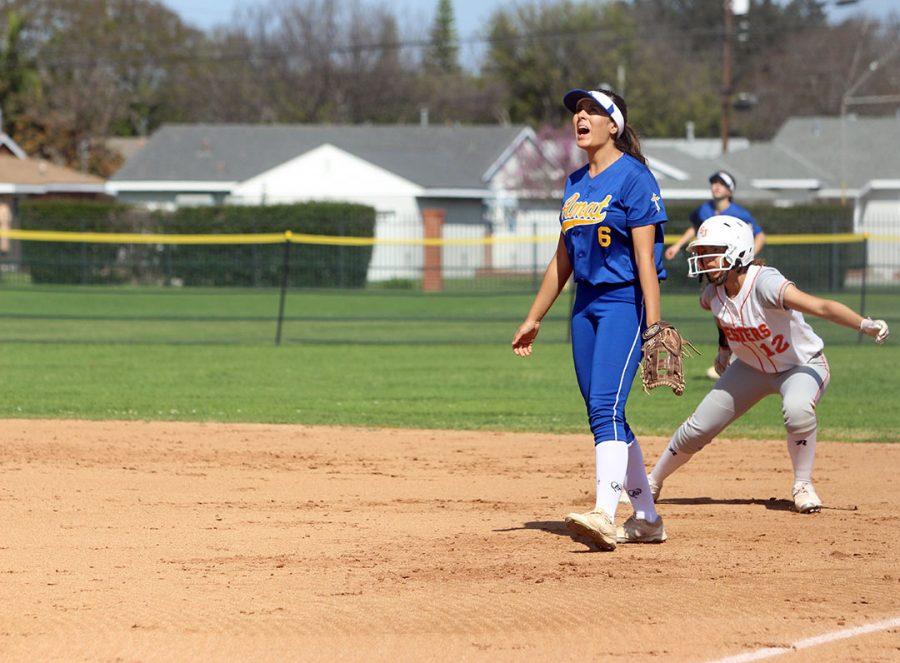 Junior Jadeyn Juarez cheers for her teammate, Amanda Hernandez