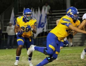 Senior Damien Moore is  starting to run with the football.