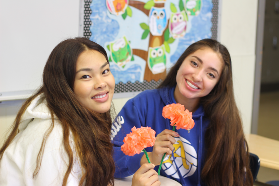 IB Spanish students making paper flowers.