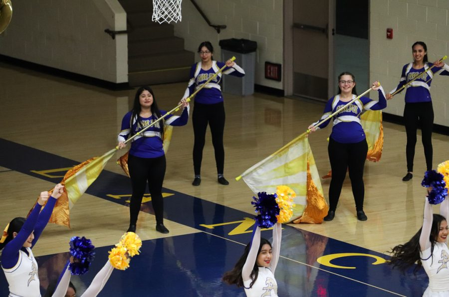 Lancer color guard are showing off what they do.