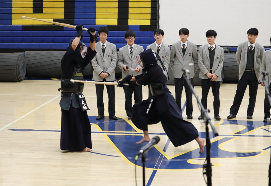 The Kendo boys are putting on some entertainment for us.