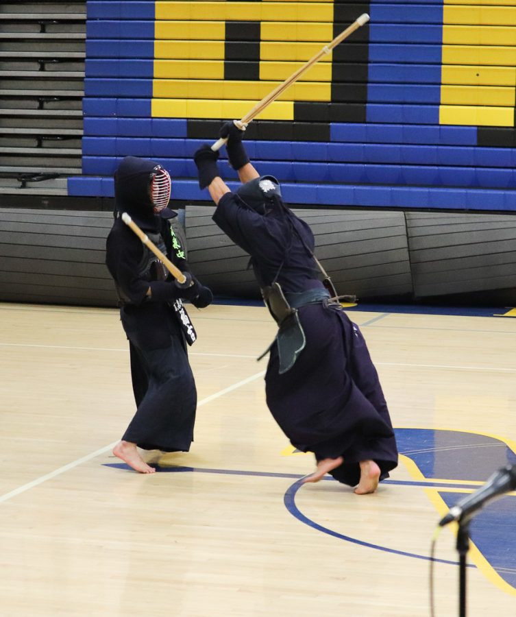Two students part of the Kendo boys put on a demonstration at the mini-rally.