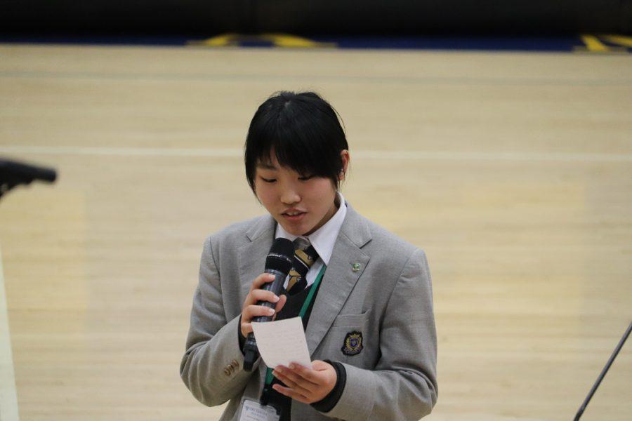 An Oki Gakuen student thanks Bishop Amat for hosting them.