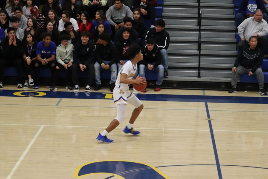 Sophomore Christian Griffin (1)  is bringing  the ball up for Bishop Amat.