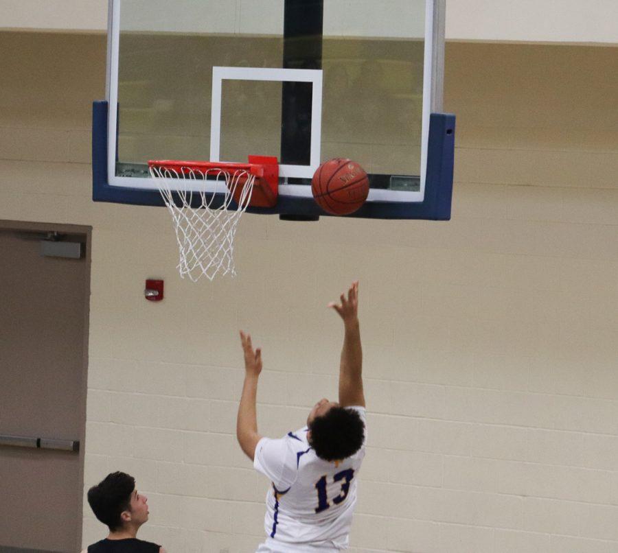 Junior Jamito Carr (13) is shoot a layup.