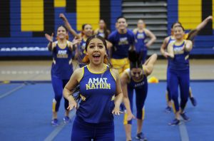 Isabella Correa cheers in front of cheer team.