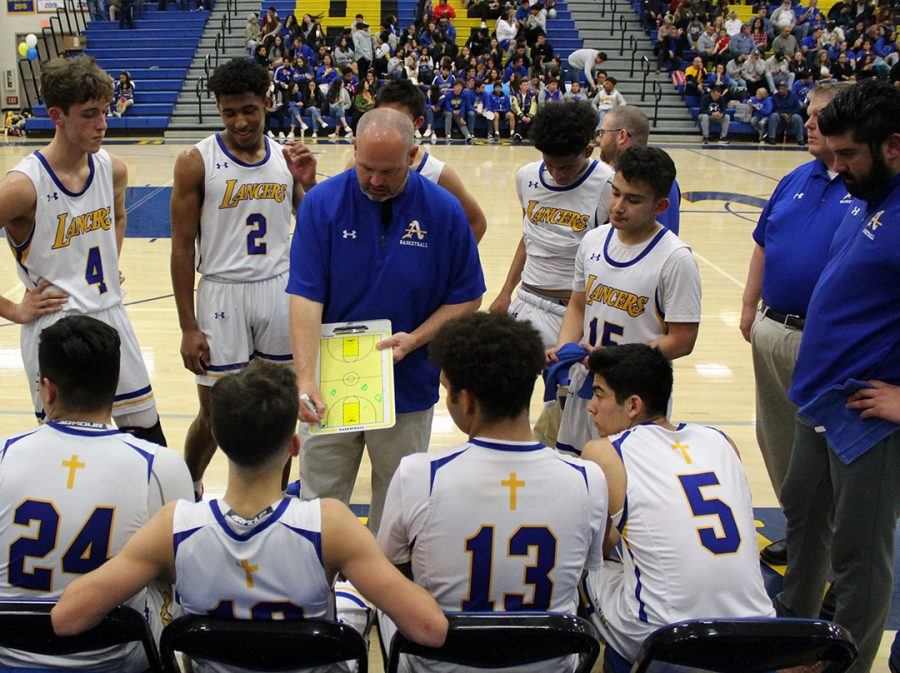Coach Ertle talks to the team during a time-out.