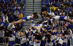 Bishop Amat's cheer team is doing a routine that takes a lot of practice.
