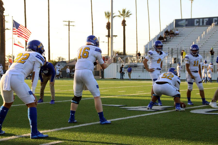 #16 Tobin ODell warming up with teammates while #52 Francisco Molina gets ready to snap the ball.