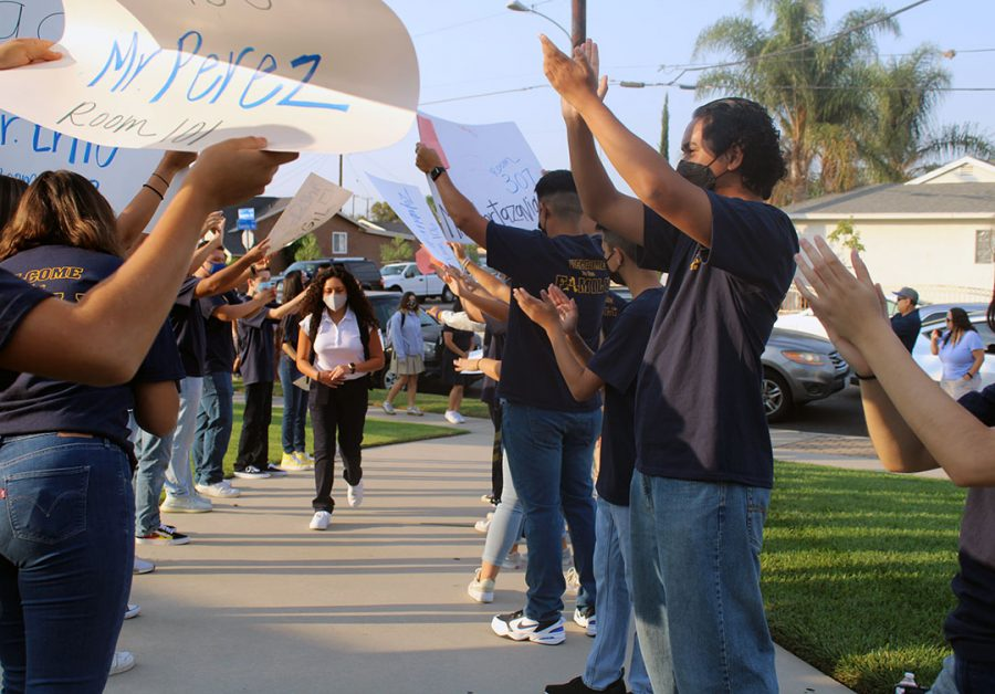 ASB Commisioners welcoming freshman with posters.