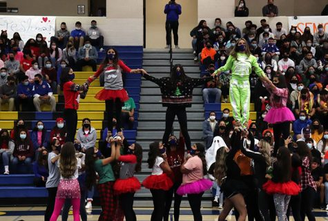 Pep squad is showing off their new routine.